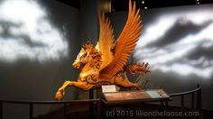 A modern take of a Pegasus as if it was a Carousel Horse.