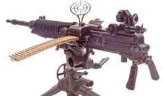 The Japanese Type 92 (M1932) 7.7mm Heavy Machine Gun ready to fire with the 30-round feed strip inserted in the feedblock, folding handles in the down position and the ejection port cover open. The front anti-aircraft ring sight is attached to its mount at the front of the receiver and the rear anti-aircraft post sight is attached to the sight bar.