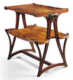 LOUIS MAJORELLE (1859-1926) TWO-TIER OCCASIONAL TABLE, CIRCA 1900 mahogany, the tops inlaid in various fruitwoods, cast bronze mounts 32¼ in. (82 cm.) high; 35½ in. (90 cm.) wide; 21 in. (53 cm.) deep top engraved L. Majorelle