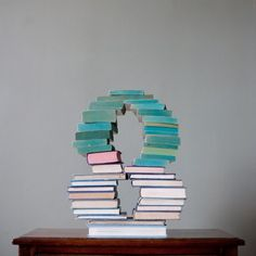 Coooool idea, to stack books into typographical shapes!