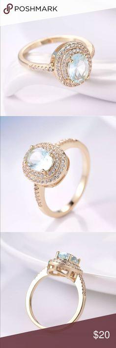 18k aquamarine white sapphire ring Beautiful and elegant 18k white gold filled aquamarine /white sapphire ring . Brand new and comes boxed Jewelry Rings