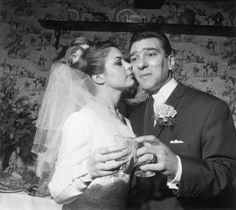 April 1965: Reginald Kray, one of the infamous Kray twins, celebrates his marriage to Frances Shae at Bethnal Green, London. Description from gettyimages.com. I searched for this on bing.com/images