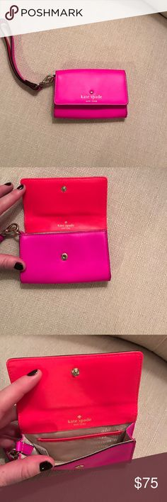 Kate Spade Wristlet Hot pink and neon orange Kate Spade wristlet with removable wrist strap. Brand new, never used. Clear ID sleeve in the back, small pocket inside the actual wristlet. kate spade Bags Clutches & Wristlets