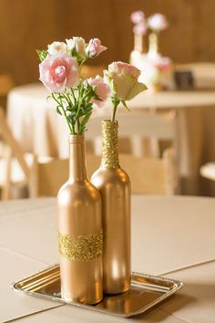 Gold wine bottles with flowers as centerpieces for Brittany & JD's Rustic Tennessee Farm Wedding - photo by Ivory Door Studios - midsouthbride.com 27 (spray paint flowers wedding)