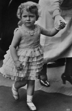 Even as a toddler, little Queen Elizabeth II (then simply the Princess) was a total style icon. Chec... - Getty