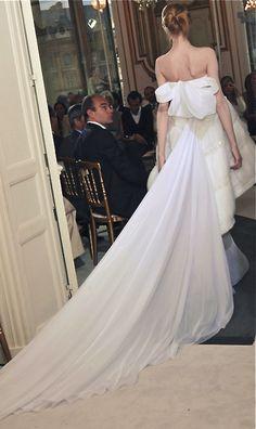 Valentino,. a wonerful back, a pure white dress.