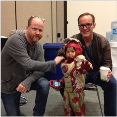 Joss Whedon, Clark Gregg and the world's tiniest Iron Man at ComicCon. Well isn't that adorable.