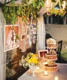 40th Wedding Anniversary {Backyard Garden Party}  They framed wedding photos in daisy edging and then have them hanging - ideas to think about for the old people