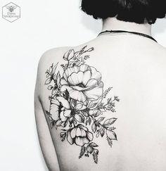 black floral tattoo by Diana Severinenko