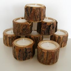 Tree limbs cut to size and hollowed out, fill with wax and a wick! Rustic candles!