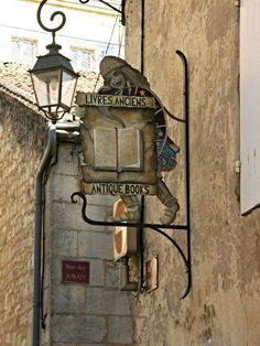 Coisas de Terê/ Not just wine in St. Emilion but a good book and a glass of wine is a good combination shop sign