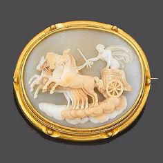 Oval shell plaque carved in high relief to depict Apollo driving his chariot, driven by four horses, within a ropetwist and beaded border, c. 1860.