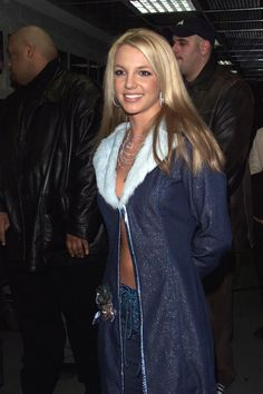 Britney Spears wearing a floor length, glittery, fur-lined denim jacket with no top underneath. The 37 Most Things That Have Ever Happened Mississippi, Fur Lined Denim Jacket, Britney Spears Photos, Britney Spears Now, Crimped Hair, Britney Jean, 2000s Fashion, Lingerie, Portrait