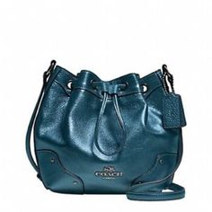 "Coach Baby Mickie drawstring bag Coach baby Mickie shoulder bag with grain leather in metallic teal/blue. Inside zip and multifunction pockets, drawstring closure & fabric lining. Strap with 23"" drop for shoulder or crossbody. Bag is 8.75""L X 7.75"" H X 4.75"" W - I will be adding pics of the actual bag but mine is straight from Coach & wrapped top to bottom, I'd like to keep most of it wrapped to protect it. Ask me any questions!! Coach Bags Crossbody Bags"