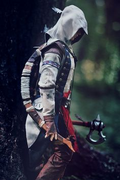 """Full cosplay of """"Assassin's Creed 3"""" charther Connor for BJD. Outfit for our customer. Costume, weapon & wig created by Amadiz Studio. Model Soom Phonolus tawny.   As a Native American assassin, eliminate your enemies with guns, bows, tomahawks, and more!"""