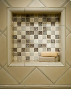 Recessed shower niche with mosaic background