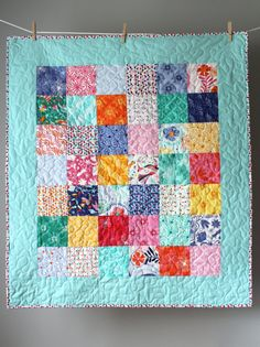Modern Baby Girl Quilt- Daydream Quilt  This modern baby girl quilt is made using the bright, cheerful Daydream collection by Kate Spain. This