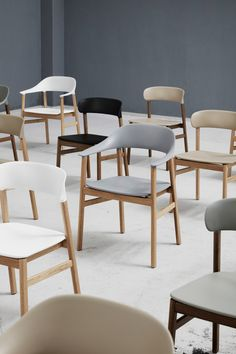 """Its curved form, which recalls the sweeping shape of mid-century Danish armchairs, is designed to follow the shape of the body while its plastic backrest and seat make it """"hard-wearing, maintenance-friendly and accessible""""."""