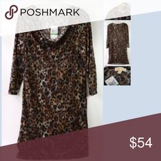 MICHAEL KORS Knit Leopard Print Dressy Top MICHAEL KORS Knit Leopard Print Dressy Top Large NWT  Long sleeves. Stretchy feel knit dressy top, great with leggings or just as a dress :)  Size: Large.From Michael Michael Kors Size Guide from: https://www.neimanmarcus.com/category/popup/MKSizeGuide.html  Large:  Size: 12-14  Bust: 37 1/2 -39  Waist: 29 - 30 1/2  Hip: 39 1/2- 41   Item new, with tag still attached. SRP: $130 MICHAEL Michael Kors Tops Blouses