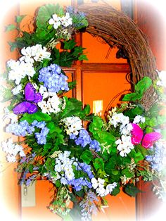 "Spring wreath, with Lavender, Purple and White...and of course some pretty butterflies... 22"" wide and 26"" in height,.....$39.99  http://www.primitivehomedecorandmore.com/floral-wreaths.html"