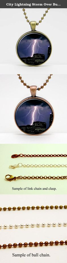 """City Lightning Storm Over Buildings Art Glass Pendant or Key Chain- 30 mm round- Chain Included- Made to Order. This image is set in a 30 mm bezel and comes complete with a 24"""" matching chain or matching key chain. Please choose from silver, copper, or bronze for the bezel and chain color. Please choose from a link chain, ball chain or key chain. This listing is for the glass art pendant and 24"""" chain, or pendant and key chain. My glass art pendants are handcrafted using a high quality..."""