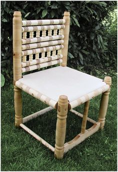 A reproduction of a Merovingian chair from a grave in Trossingen (no. 58). The chair is about 90 inches high and its seat height of 43-44 cm is roughly equivalent to today's standard. The chair is made of maple.