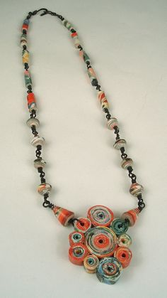 Rolled paper bead necklace.