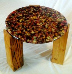 Resin table top embedded with rose petals by Fogliart