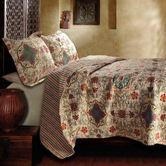 Add extra warmth to your bedding and a modern, youthful feel to your decor with this reversible, three-piece quilt set. Featuring a jewel-toned, floral motif on one side and coordinating stripes on the other, this coverlet is both versatile and lovely.