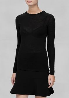 A wardrobe essential, this sheer long-sleeved t-shirt has a classic fit and is made from soft wool for smart layering. • Round neck• Long fitted sleeves• Rolled edges at the hem and sleeves• Model wears: UK 10/EU 36 Length of t-shirt: 62 cm (size 36)