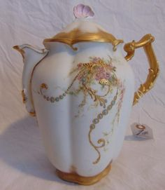 LOT 1 Seller's Estimate: USD 75 - 125 Hand painted and gold decorated Limoges tea pot, unsigned, but artist signed: Matilda Stark, December 25, 1892, in excellent condition (8 H w/top). Payment: The b
