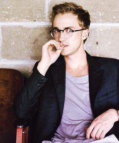 Tom Felton looking geeky. How is it possible to look that sexy?!