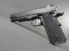 Sig Sauer 1911 Tactical Operations 45acp with stainless steel frame, low profile night sights, magwell, ambidextrous controls, and Ergo XT grips.