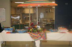 Use of beach umbrella for beach themed graduation