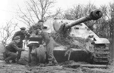 British troops inspecting an immobilized German Jadgapanzer, anti-tank gun.