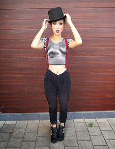 I like the red suspenders against a black shirt and the high-waisted skinny jeans.