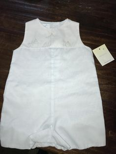 Absolutely precious onesie. Light baby blue nautical design with sailboats details at the top.