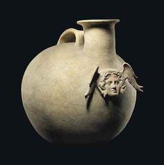 A CANOSAN POTTERY ASKOS     APULIA, CIRCA 4TH-EARLY 3RD CENTURY B.C.