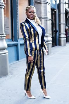 Claire Sulmers Kimberly Goldson gold and navy suit miu miu clutch saint laurent bone pumps 7