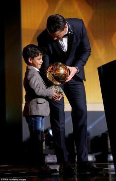 Ronaldo hands over the Ballon d'Or to his son, Cristiano Ronaldo Jr, on the podium in Zuri...