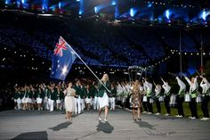 2012 Olympic Games - Opening Ceremony - LONDON, ENGLAND - JULY 27: Australian basketballer and flag bearer Lauren Jackson leads the Australian team into the stadium during the Opening Ceremony of the London 2012 Olympic Games at the Olympic Stadium on July 27, 2012 in London, England. © Cameron Spencer/Getty Images