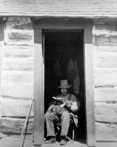 """""""Skip Roosevelt's Preferred Spot: President Theodore Roosevelt reads in the doorway of a house"""