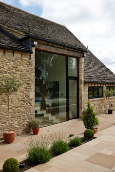Large structural glazing units used to introduce light into a converted stone faced barn.