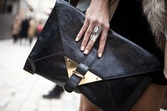 black envelope clutch with gold clasp