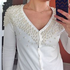 Sew pearls all over a sweater.