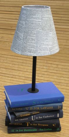 Wouldn't you love your own custom book lamp made from your favorite books?  This custom lamp is perfect for Sue Grafton mystery fans!  #books #decor #stacked #lamp #bookish #library #office #lighting #mybooklandia #upcycled #recycled #repurposed #grafton #mystery #detective #novel #fiction
