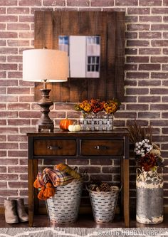 Updating your foyer for fall? Combine galvanized metal pieces with pops of warm colors to create an autumn ambience!