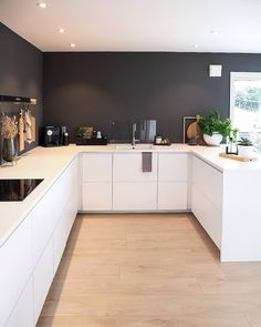 Minimalistic black and white kichen design . Combined with a light wooden floor . Home Decor Kitchen, Kitchen Interior, Home Interior Design, Kitchen Design, Apartment Therapy, Apartment Design, Light Wooden Floor, Scandinavian Style Home, Beautiful Houses Interior
