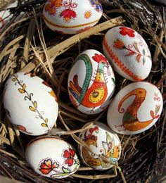 The Picture Is Of Daintily Handpainted Easter Eggs Displayed For Sale At A