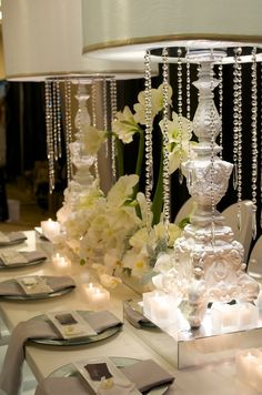 This is a fabulous tablescape I captured at a Bridal Expo Chicago Luxury event. I specialize in photographing objects in the most beautiful way possible. I can research the company if anyone is interested. elegant, table decor, wedding, floral, crystal, Angela Swan, tabletop, party, bridal, bride, reception, event, decoration, orchid, chicago